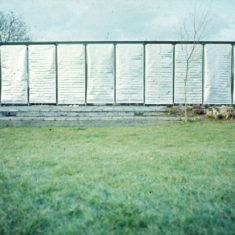 Fluy House 1978 south facade with silver perforated aluminium coated glass fibre